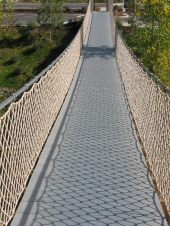 "<h5>Bridge Netting</h5><p>This bridge used our playpark netting on the sides to keep people safe as they walked across. It's child friendly and doesn't let anyone slip through.</br> Learn more about <a href=""/netting-products/playpark-netting/"">playpark netting</a>.</br> <a href=""/portfolio/bridge-netting/"">See all the pictures.</a>																																																																																																																																																																																																																																														</p>"